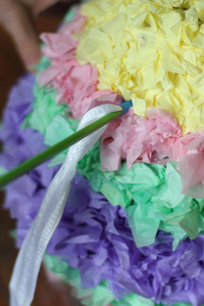 Adding a rope to the easter pinata