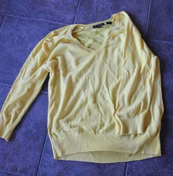 Yellow sweater after using DIY clothes whitener
