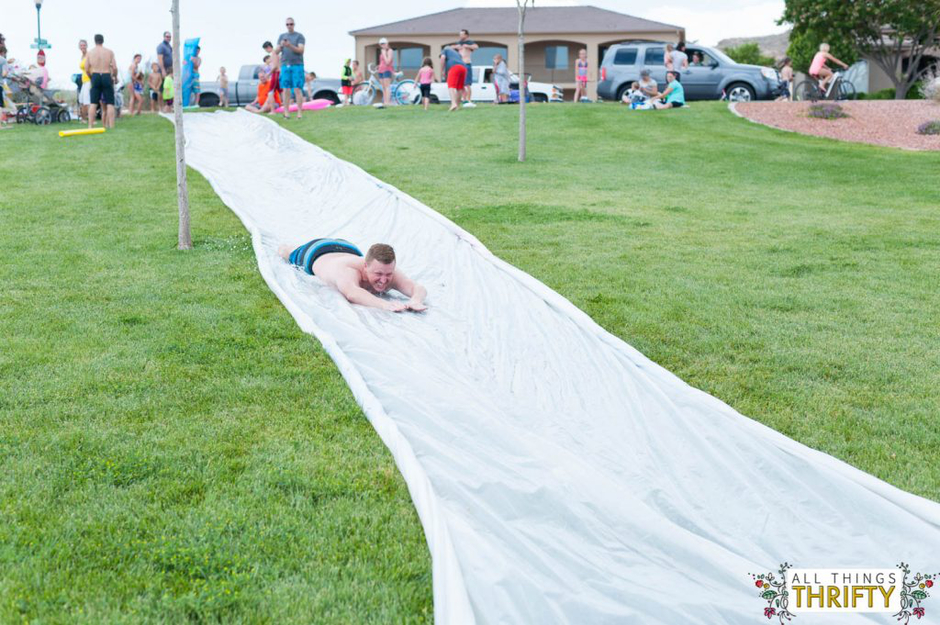 Extra large slip and slide with person sliding down