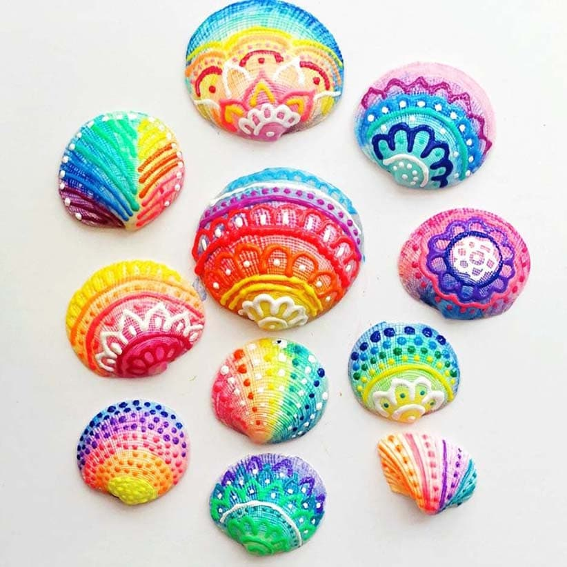 Colorful seashells painted with puff paint