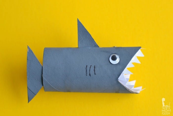 Toilet roll shark on yellow background