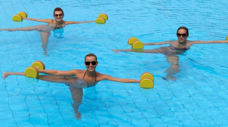 people working out in a swimming pool