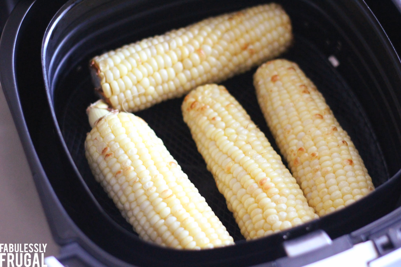 Perfectly air fried corn on the cob in air fryer basket